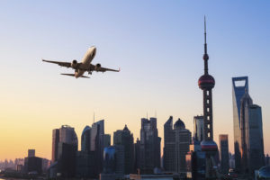 shanghai skyline with airplane