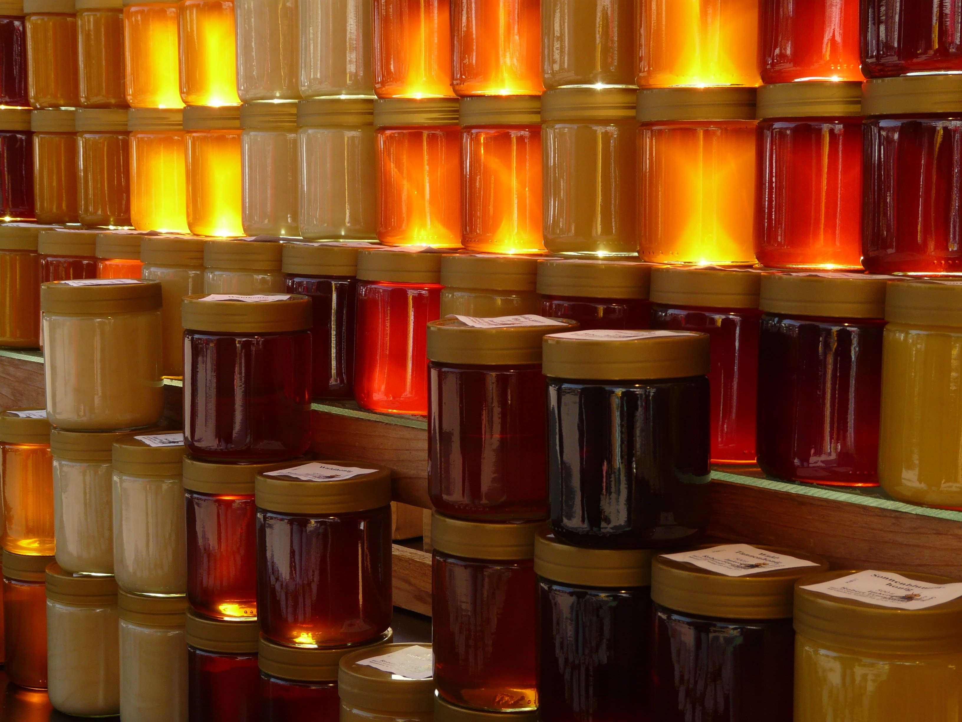 food and beverage - rotten documentary - honey jars stacked honey industry food fraud
