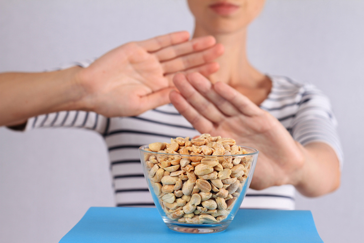 food and beverage industry allergies person rejecting peanuts